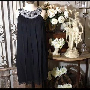 Maggie London cut in shoulder silk dress